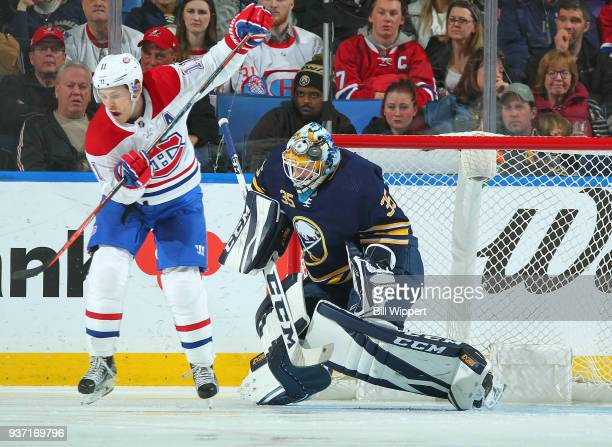 Brendan Gallagher of the Montreal Canadiens deflects the puck against Linus Ullmark of the Buffalo Sabres during an NHL game on March 23 2018 at...