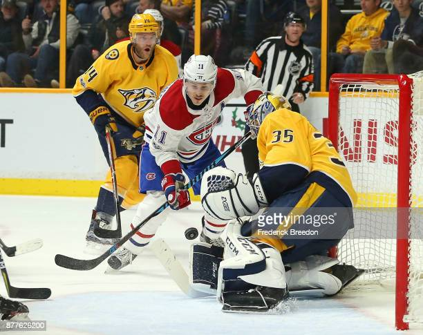 Brendan Gallagher of the Montreal Canadiens fights for a puck in front of goalie Pekka Rinne of the Nashville Predators during the second period at...