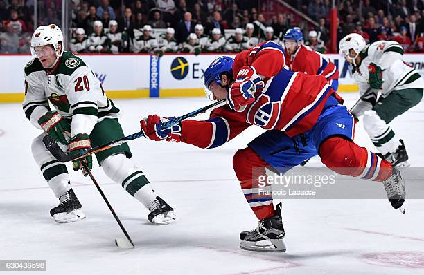 Brendan Gallagher of the Montreal Canadiens fires a shot against the Minnesota Wild in the NHL game at the Bell Centre on December 22 2016 in...