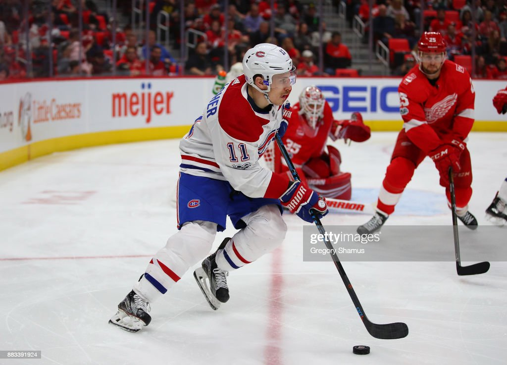 Brendan Gallagher #11 of the Montreal Canadiens heads up ice in front of Jimmy Howard #35 of the Detroit Red Wings during the third period at Little Caesars Arena on November 30, 2017 in Detroit, Michigan. Montreal won the game 6-3.
