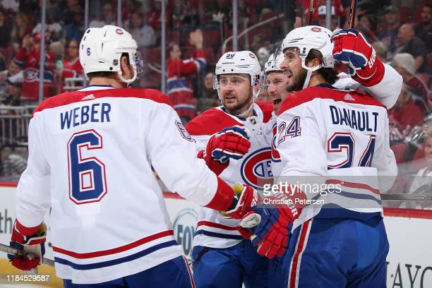Brendan Gallagher of the Montreal Canadiens is congratulated by Shea Weber, Tomas Tatar, and Phillip Danault after scoring against the Arizona...