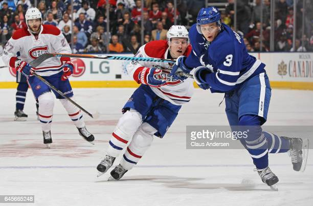 Brendan Gallagher of the Montreal Canadiens is held up by Alexey Marchenko of the Toronto Maple Leafs during an NHL game at the Air Canada Centre on...