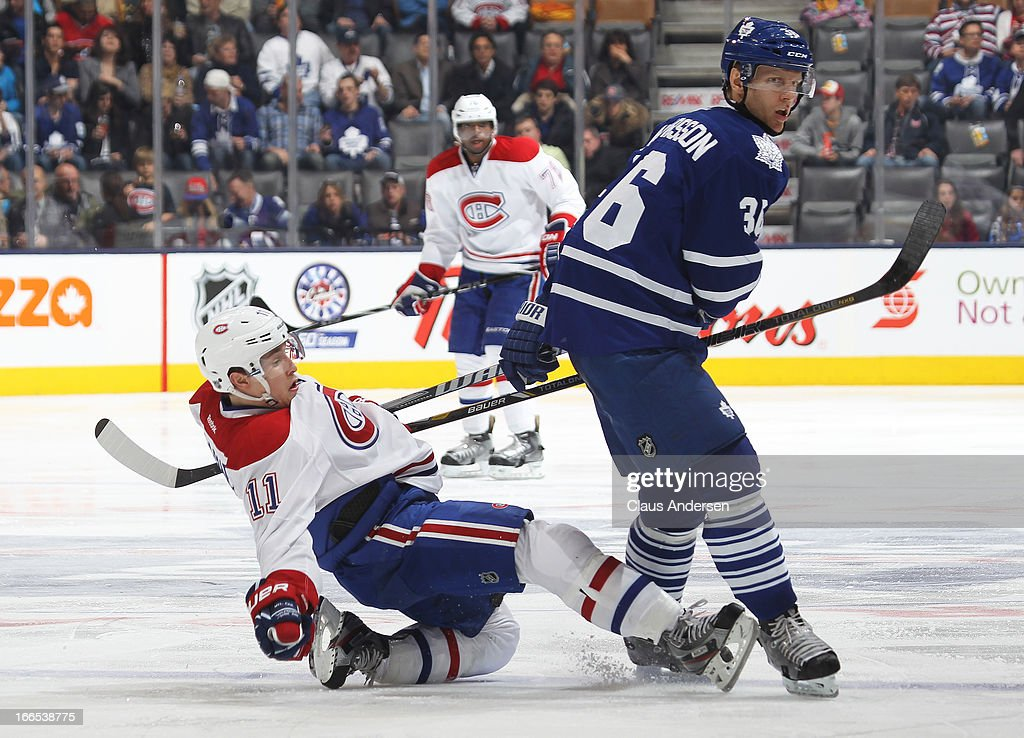 Brendan Gallagher #11 of the Montreal Canadiens is knocked to the ice by Carl Gunnarsson #36 of the Toronto Maple Leafs in a game on April 13, 2013 at the Air Canada Centre in Toronto, Ontario, Canada. The Leafs defeated the Canadiens 5-1.