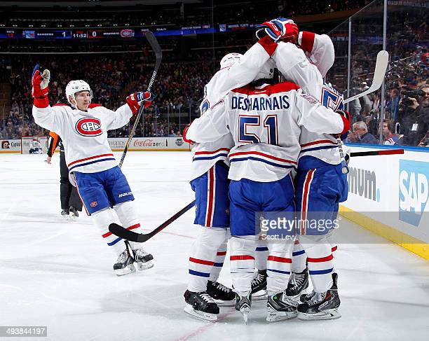 Brendan Gallagher of the Montreal Canadiens looks to join the rest of his teammates as they celebrate scoring a goal by Francis Bouillon in the...