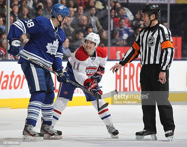 Brendan Gallagher of the Montreal Canadiens looks up at a menacing Frazer McLaren of the Toronto Maple Leafs in a game against the Toronto Maple...