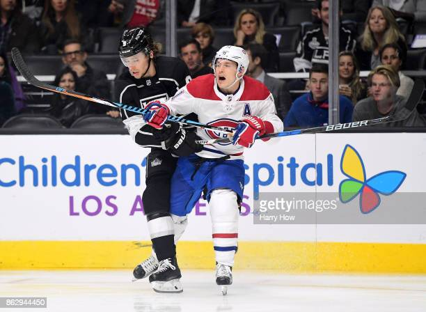 Brendan Gallagher of the Montreal Canadiens reacts as he takes a hit from Adrian Kempe of the Los Angeles Kings during the second period at Staples...