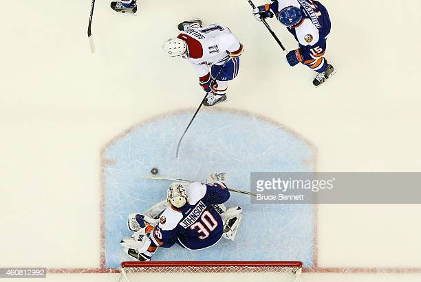 Brendan Gallagher of the Montreal Canadiens scores a second period goal past Chad Johnson of the New York Islanders at Nassau Veterans Memorial...