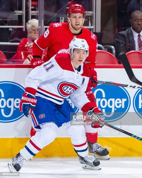 Brendan Gallagher of the Montreal Canadiens skates in front of Anthony Mantha of the Detroit Red Wings during an NHL game at Little Caesars Arena on...