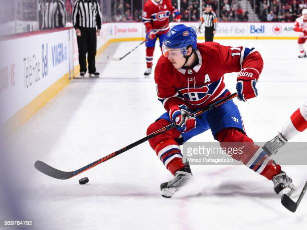 Brendan Gallagher of the Montreal Canadiens skates the puck against the Detroit Red Wings during the NHL game at the Bell Centre on March 26 2018 in...