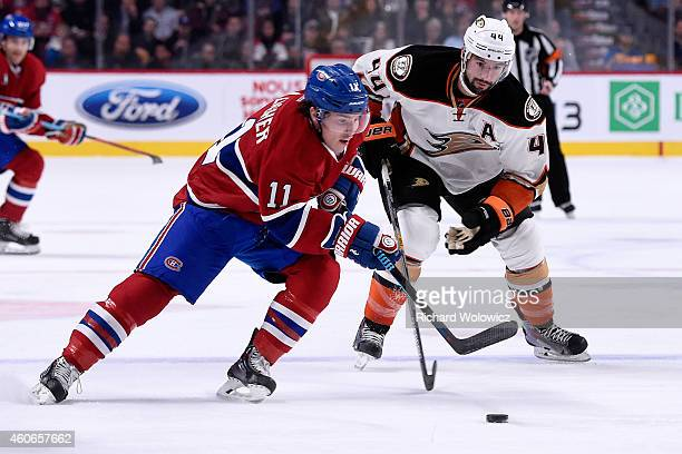 Brendan Gallagher of the Montreal Canadiens skates with the puck in front of Nate Thompson of the Anaheim Ducks during the NHL game at the Bell...