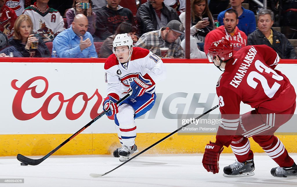 Brendan Gallagher #11 of the Montreal Canadiens skates with the puck ahead of Oliver Ekman-Larsson #23 of the Arizona Coyotes during the NHL game at Gila River Arena on March 7, 2015 in Glendale, Arizona. The Canadiens defeated the Coyotes 2-0.