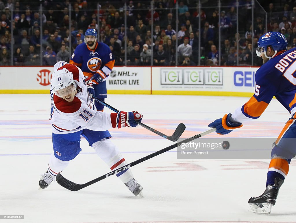 Brendan Gallagher #11 of the Montreal Canadiens takes a slapshot against the New York Islanders at the Barclays Center on October 26, 2016 in the Brooklyn borough of New York City. The Canadiens defeated the Islanders 3-2.