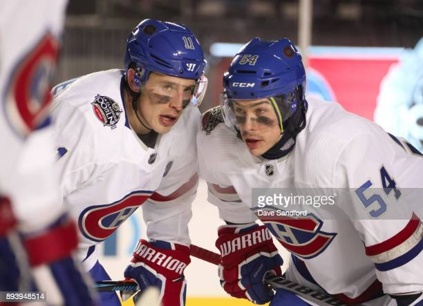Brendan Gallagher of the Montreal Canadiens talks with teammate Charles Hudon between whistles during the 2017 Scotiabank NHL100 Classic at Lansdowne...
