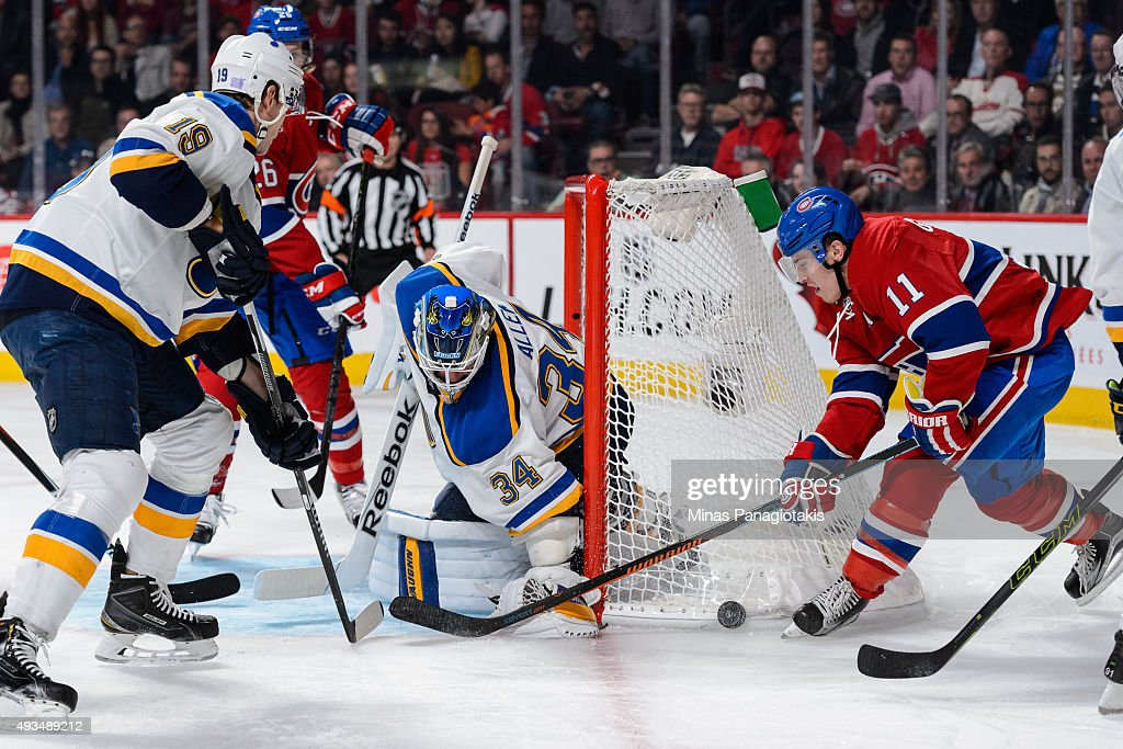 Brendan Gallagher #11 of the Montreal Canadiens tries to get the puck near the net of goaltender Jake Allen #34 of the St. Louis Blues during the NHL game at the Bell Centre on October 20, 2015 in Montreal, Quebec, Canada.