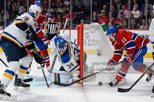 Brendan Gallagher of the Montreal Canadiens tries to get the puck near the net of goaltender Jake Allen of the St. Louis Blues during the NHL game at...