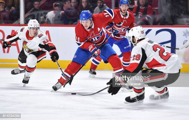 Brendan Gallagher of the Montreal Canadiens tries to keep the puck from Johnny Oduya and JeanGabriel Pageau of the Ottawa Senators in the NHL game at...
