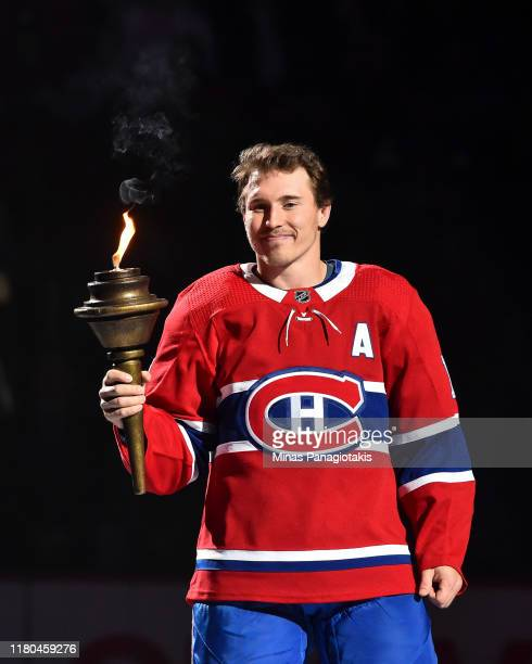 Brendan Gallagher takes part in the opening ceremony prior to their home game against the Detroit Red Wings at the Bell Centre on October 10, 2019 in...