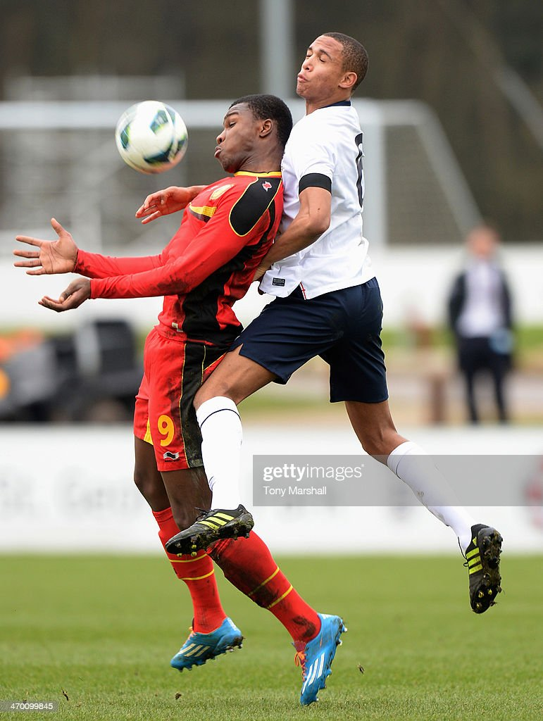 Brendan Galloway of England challenges Mamadou Obbi Oulare of Belgium in the air during the England v Belgium - U18 International Friendly match at St Georges Park on February 18, 2014 in Burton-upon-Trent, England.