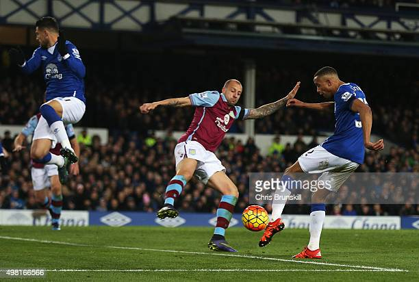 Brendan Galloway of Everton and Alan Hutton of Aston Villa compete for the ball during the Barclays Premier League match between Everton and Aston...