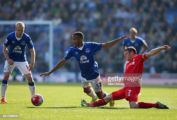 Brendan Galloway of Everton and James Milner of Liverpool in action during the Barclays Premier League match between Everton and Liverpool at...
