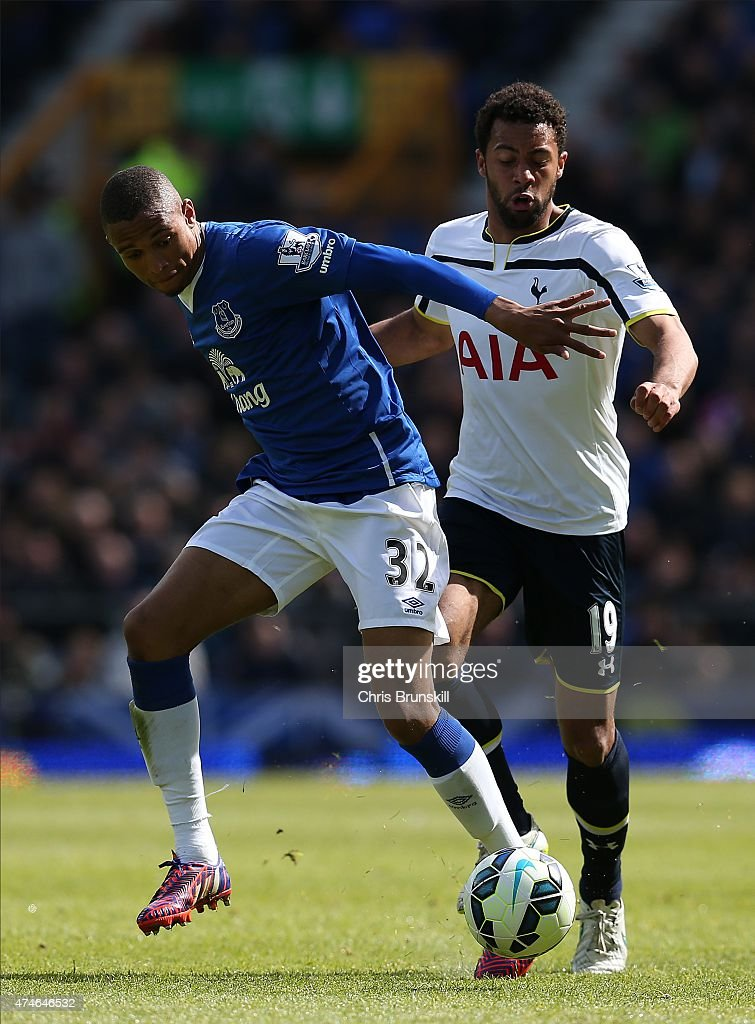 Brendan Galloway of Everton in action with Moussa Dembele of Tottenham Hotspur during the Barclays Premier League match between Everton and Tottenham Hotspur at Goodison Park on May 24, 2015 in Liverpool, England.