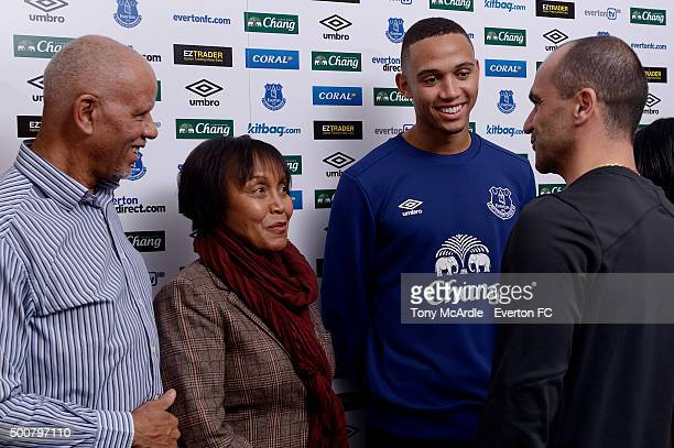 Brendan Galloway of Everton signs a new contract with members of his family at Finch Farm on December 10, 2015 in Liverpool, England.