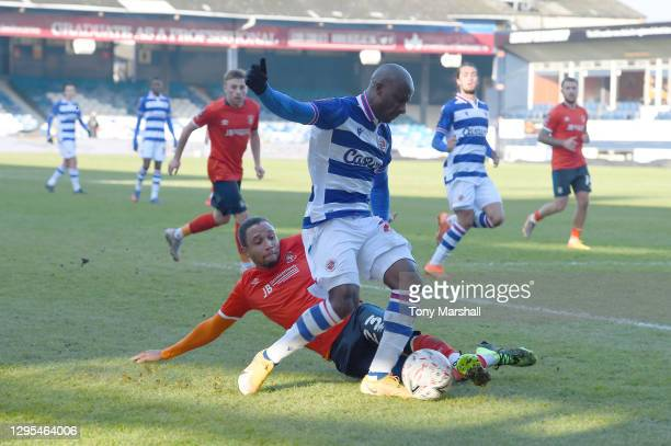 Brendan Galloway of Luton Town challenges Sone Aluko of Reading during the FA Cup Third Round match between Luton Town and Reading at Kenilworth Road...