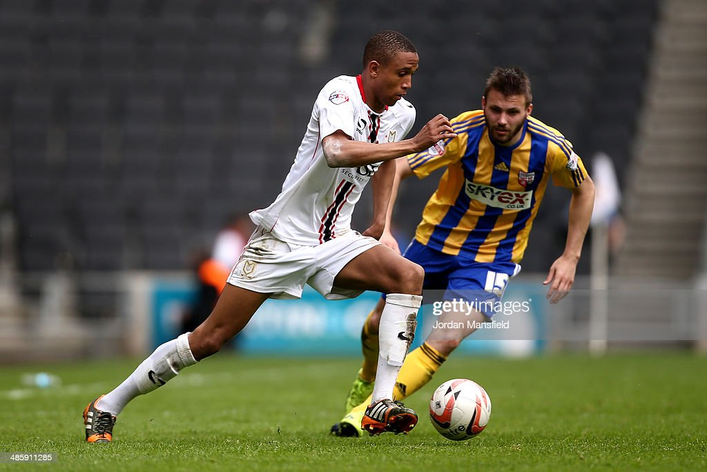Brendan Galloway of MK Dons takes the ball past Stuart Dallas of Brentford during the Sky Bet League One match between MK Dons and Brentford at Stadium mk on April 21, 2014 in Milton Keynes, England.