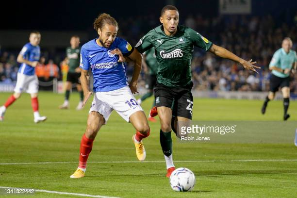 Brendan Galloway of Plymouth Argyle and Marcus Harness of Portsmouth FC challenge for the ball during the Sky Bet League One match between Portsmouth...