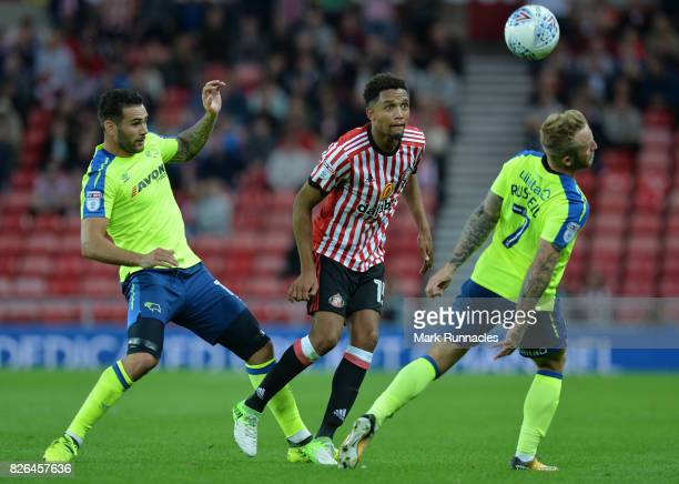 Brendan Galloway of Sunderland takes on Bradley Johnson and Johnny Russell of Derby County during the Sky Bet Championship match between Sunderland...