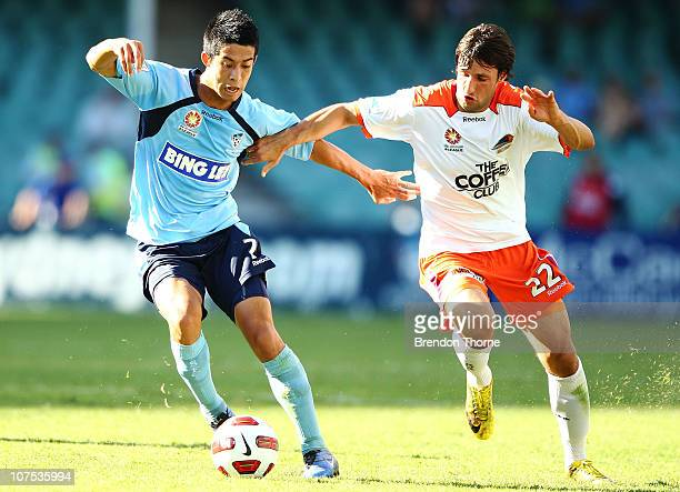 Brendan Gan of Sydney competes with Thomas Broich of the Roar during the round 18 ALeague match between Sydney FC and the Brisbane Roar at Sydney...
