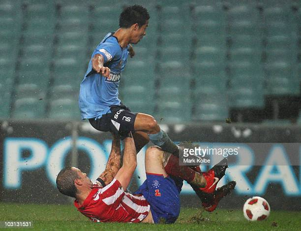 Brendan Gan of Sydney FC is tackled by David Weir of the Rangers during the pre-season friendly match between Sydney FC and Glasgow Rangers at the...