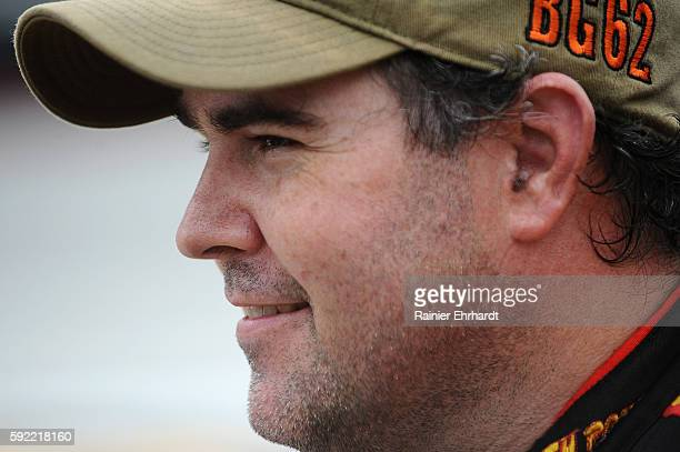 Brendan Gaughan driver of the South Point Chevrolet stands on the grid during qualifying for the NASCAR XFINITY Series Food City 300 at Bristol Motor...