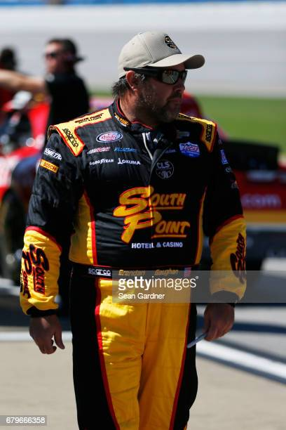 Brendan Gaughan driver of the South Point Hotel Casino Chevrolet stands on the grid during qualifying for the NASCAR XFINITY Series Sparks Energy 300...