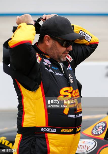 Brendan Gaughan driver of the South Point Hotel Casino Chevrolet stands on the grid during qualifying for the NASCAR XFINITY Series OneMain Financial...