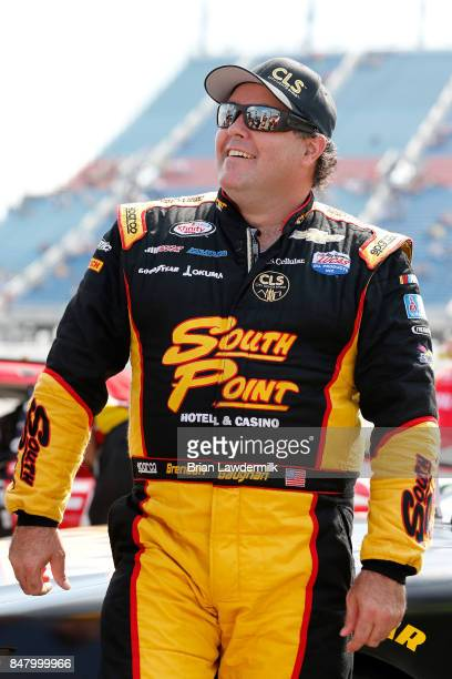 Brendan Gaughan driver of the South Point Hotel Casino Chevrolet stands on the grid prior to the NASCAR XFINITY Series TheHousecom 300 at Chicagoland...
