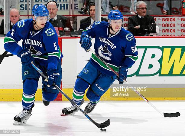 Brendan Gaunce and Luca Sbisa of the Vancouver Canucks skate up ice during their NHL game against the San Jose Sharks at Rogers Arena March 3 2016 in...