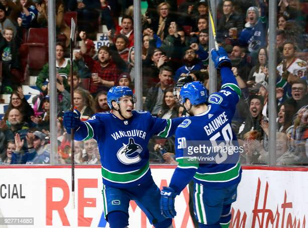 Brendan Gaunce is congratulated by teammates Bo Horvat of the Vancouver Canucks after scoring during their NHL game against the Chicago Blackhawks at...