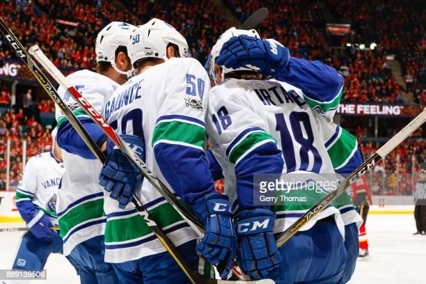Brendan Gaunce Jake Virtanen and Michael Chaput of the Vancouver Canucks celebrate scoring in a NHL game against the Vancouver Canucks at the...