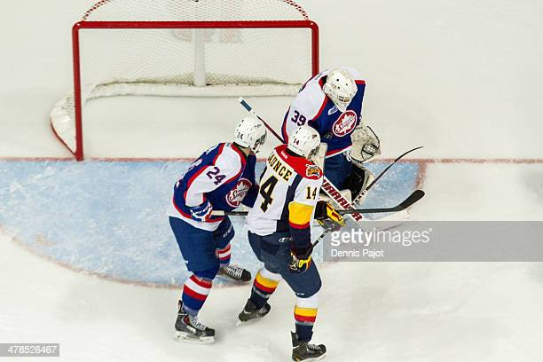 Brendan Gaunce of the Erie Otters battles out front for a deflection against Alex Fotinos of the Windsor Spitfires on March 13 2014 at the WFCU...