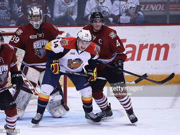 Brendan Gaunce of the Erie Otters skates against Matt Finn of the Guelph Storm in Game Two of the OHL Western Conference Final at the Sleeman Centre...