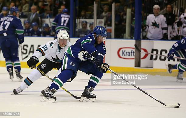 Brendan Gaunce of the San Jose Sharks defends against Matt Bartkowski of the Vancouver Canucks during Day 3 of NHL Kraft Hockeyville at the Q Centre...