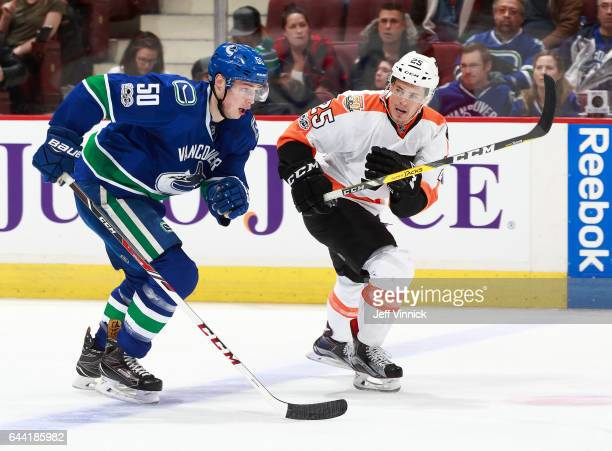 Brendan Gaunce of the Vancouver Canucks and Nick Cousins of the Philadelphia Flyers skate up ice during their NHL game at Rogers Arena February 19...