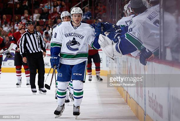 Brendan Gaunce of the Vancouver Canucks celebrates with teammates on the bench after scoring a first period goal against the Arizona Coyotes during...