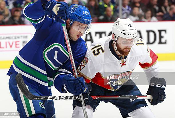 Brendan Gaunce of the Vancouver Canucks checks Paul Thompson of the Florida Panthers during their NHL game at Rogers Arena January 20 2017 in...