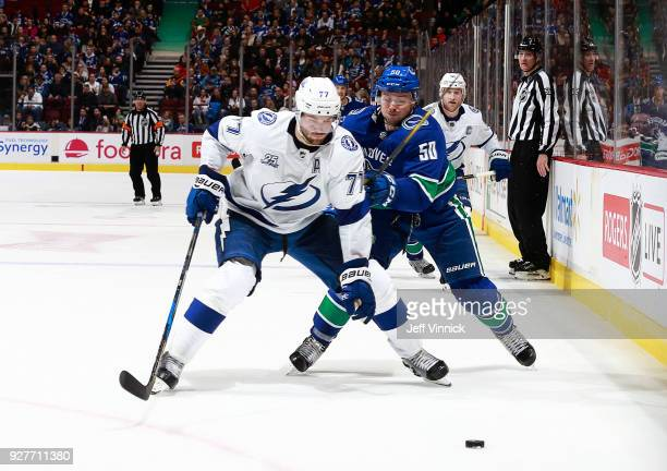 Brendan Gaunce of the Vancouver Canucks checks Victor Hedman of the Tampa Bay Lightning during their NHL game at Rogers Arena February 3 2018 in...