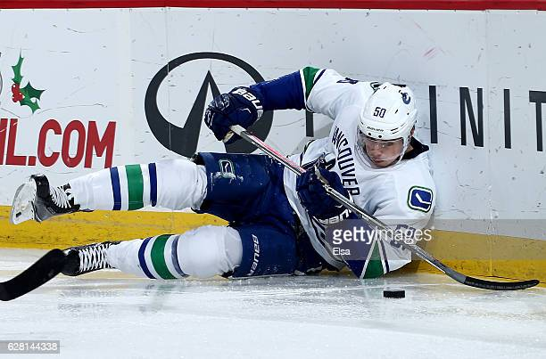 Brendan Gaunce of the Vancouver Canucks falls as he tries to keep control of the puck in the third period against the New Jersey Devils on December 6...