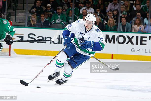 Brendan Gaunce of the Vancouver Canucks handles the puck against the Dallas Stars at the American Airlines Center on October 29 2015 in Dallas Texas
