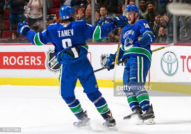 Brendan Gaunce of the Vancouver Canucks is congratulated by Christopher Tanev after scoring during their NHL game against the Chicago Blackhawks at...