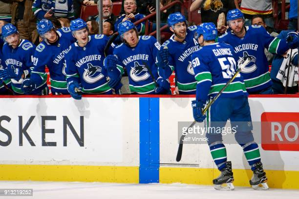 Brendan Gaunce of the Vancouver Canucks is congratulated by teammates after scoring during their NHL game against the Chicago Blackhawks at Rogers...